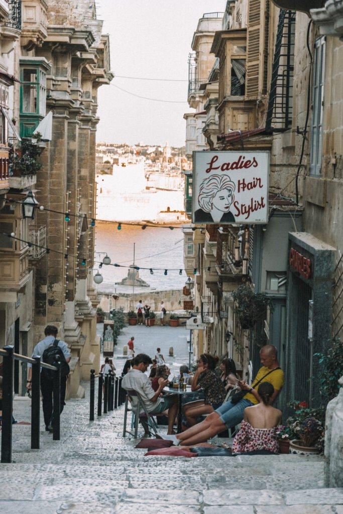 People having dinner on a cozy street in Valetta Malta
