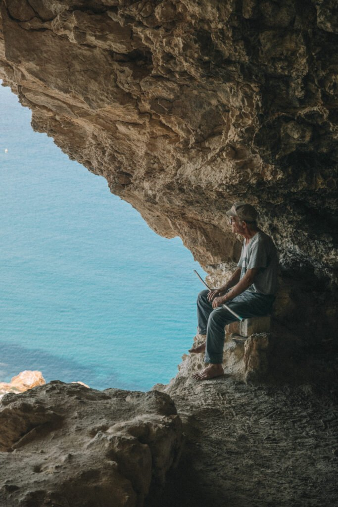 Guy looking out of Tal-Mixta Cave