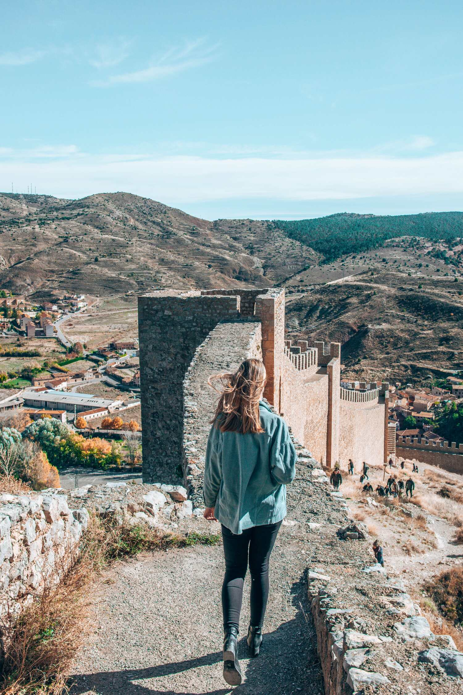 Walking the city wall above of the enchanting city Albarracin in Spain.