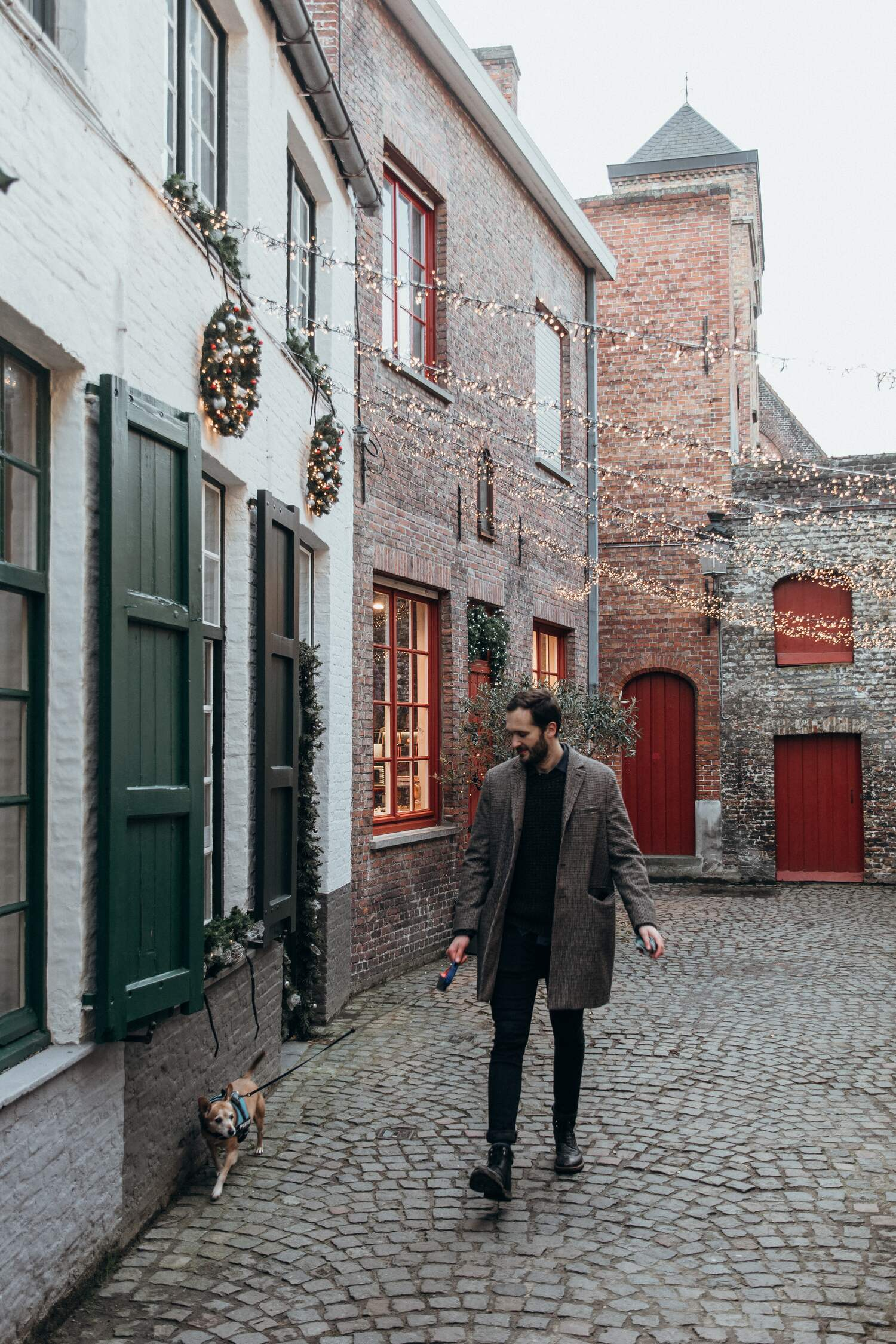 Walking the back streets with our dog in Brugge Belgium