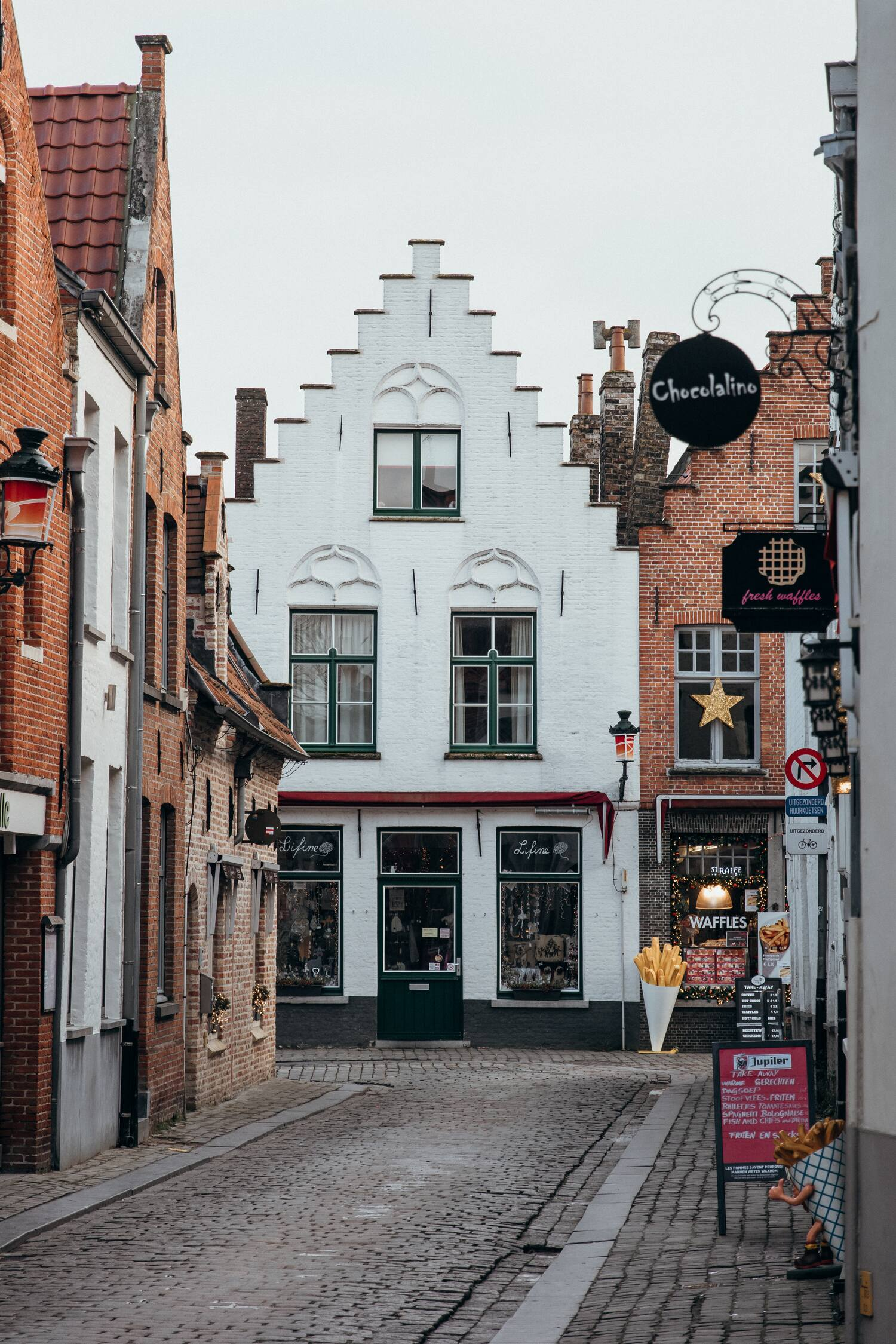 The backstreets and a fries shop in Bruges Belgium