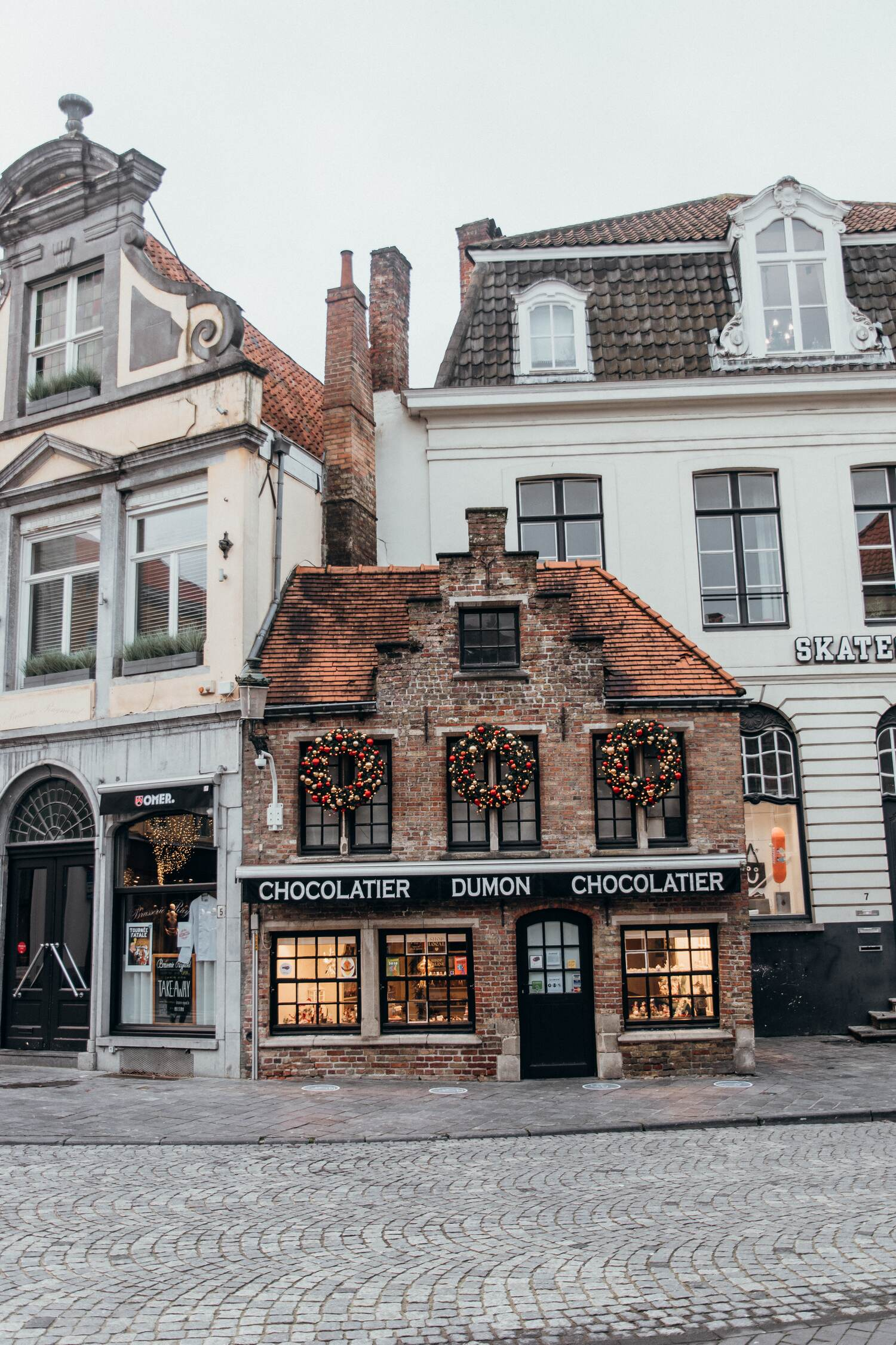 One of the many Bruges chocolate shops which are a must visit during a short break in Bruges
