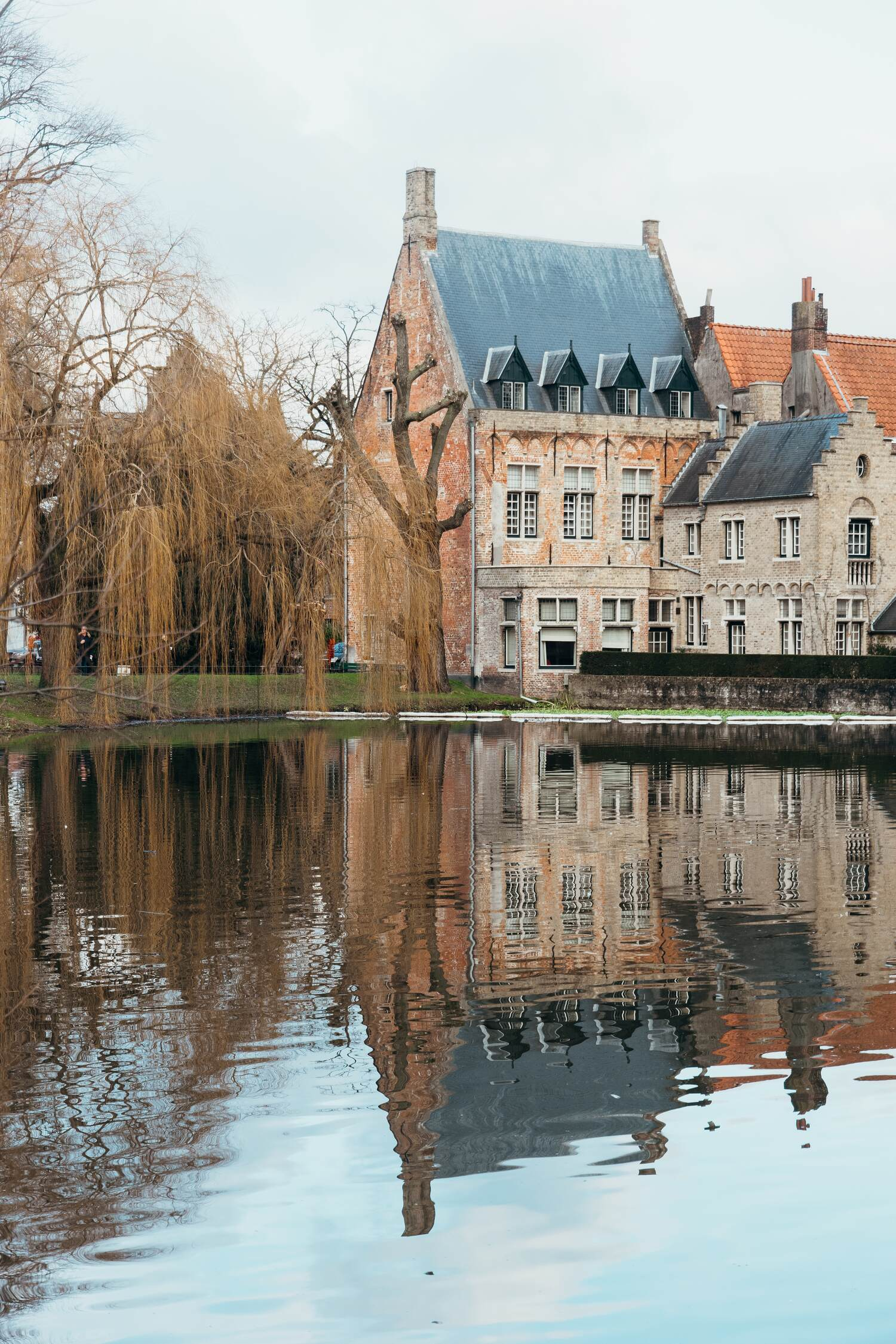 The Minnewaterpark Brugge which is a lake as you enter the city centre of Bruges on a Bruges city break