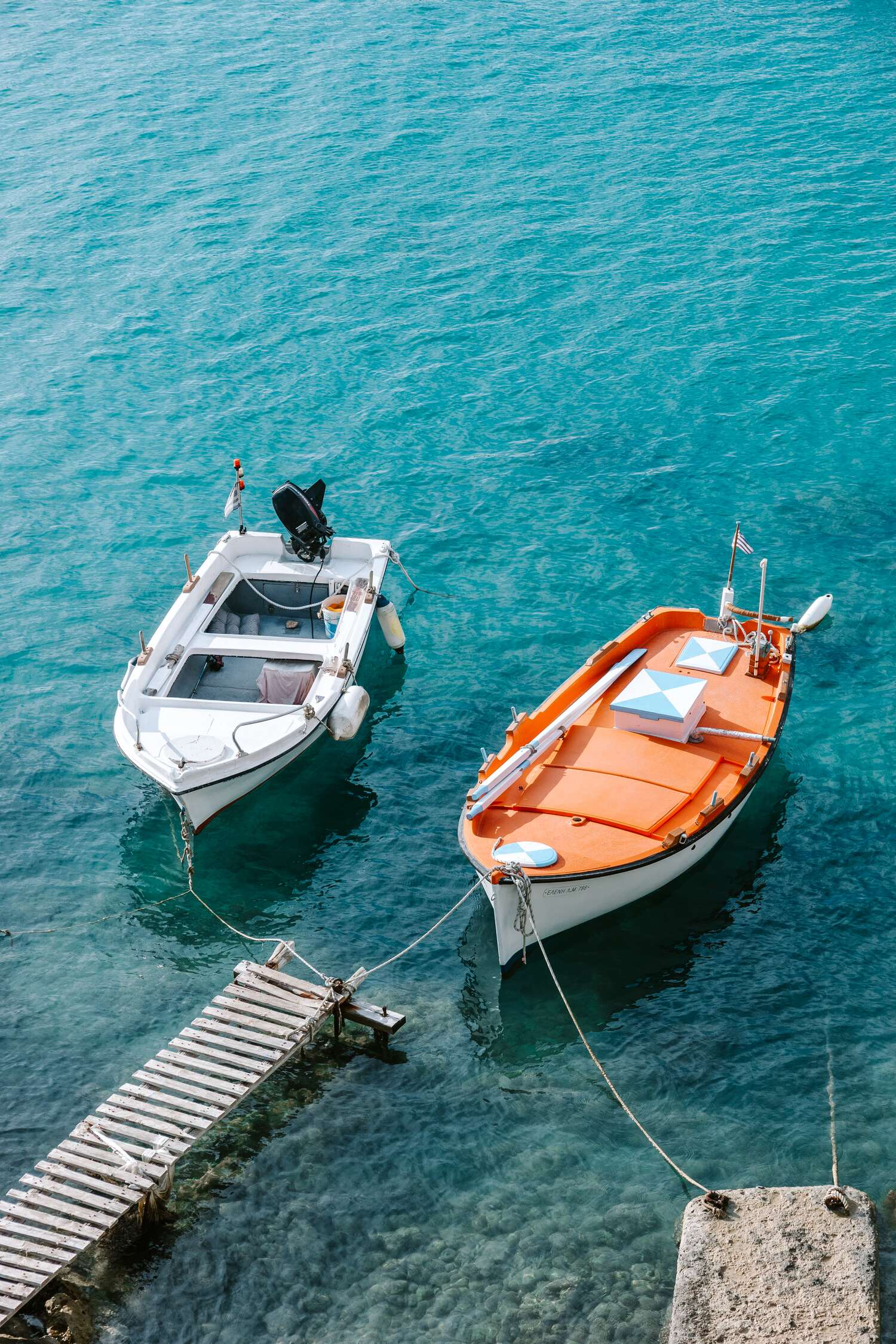 The blue water of Firopotamos Milos Beach