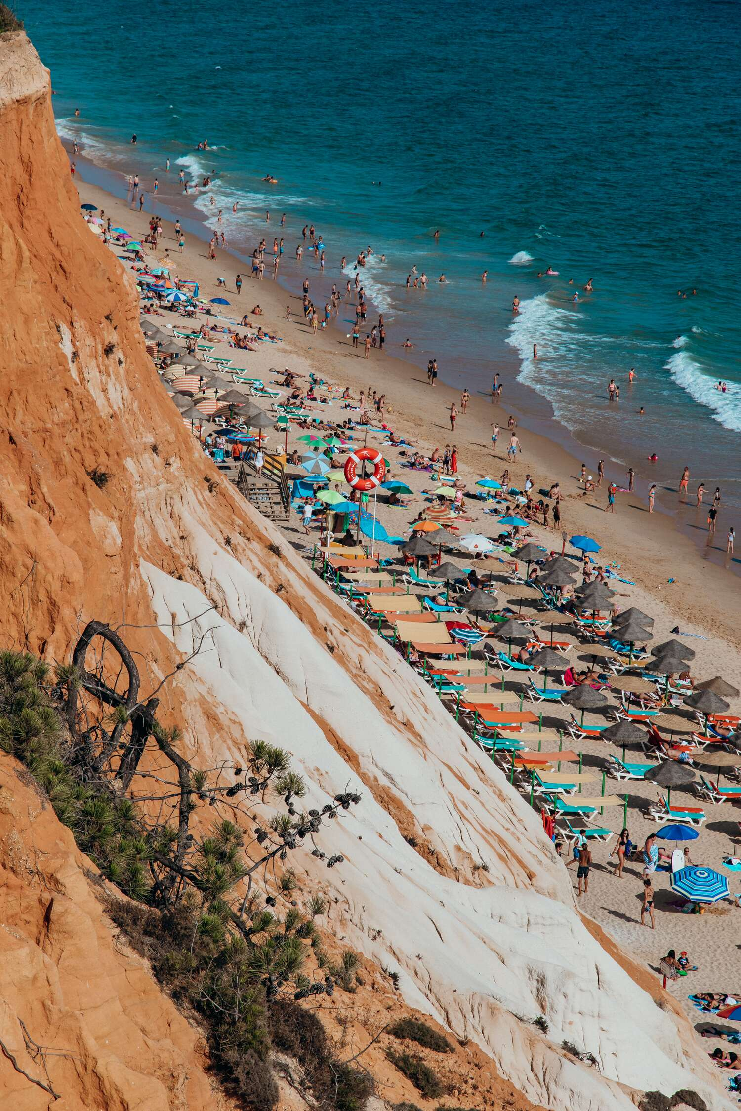 The red cliffs of Praia da Falesia is a must visit location when venturing on a Portugal road trip of the coast