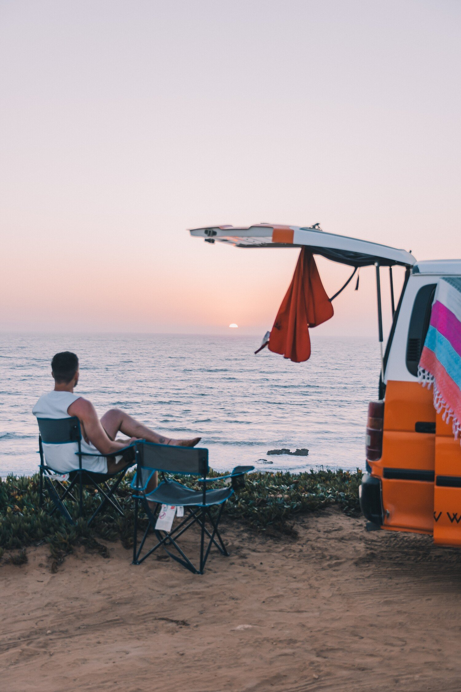 Taking in the sunset during our van trip road trip of Portugal