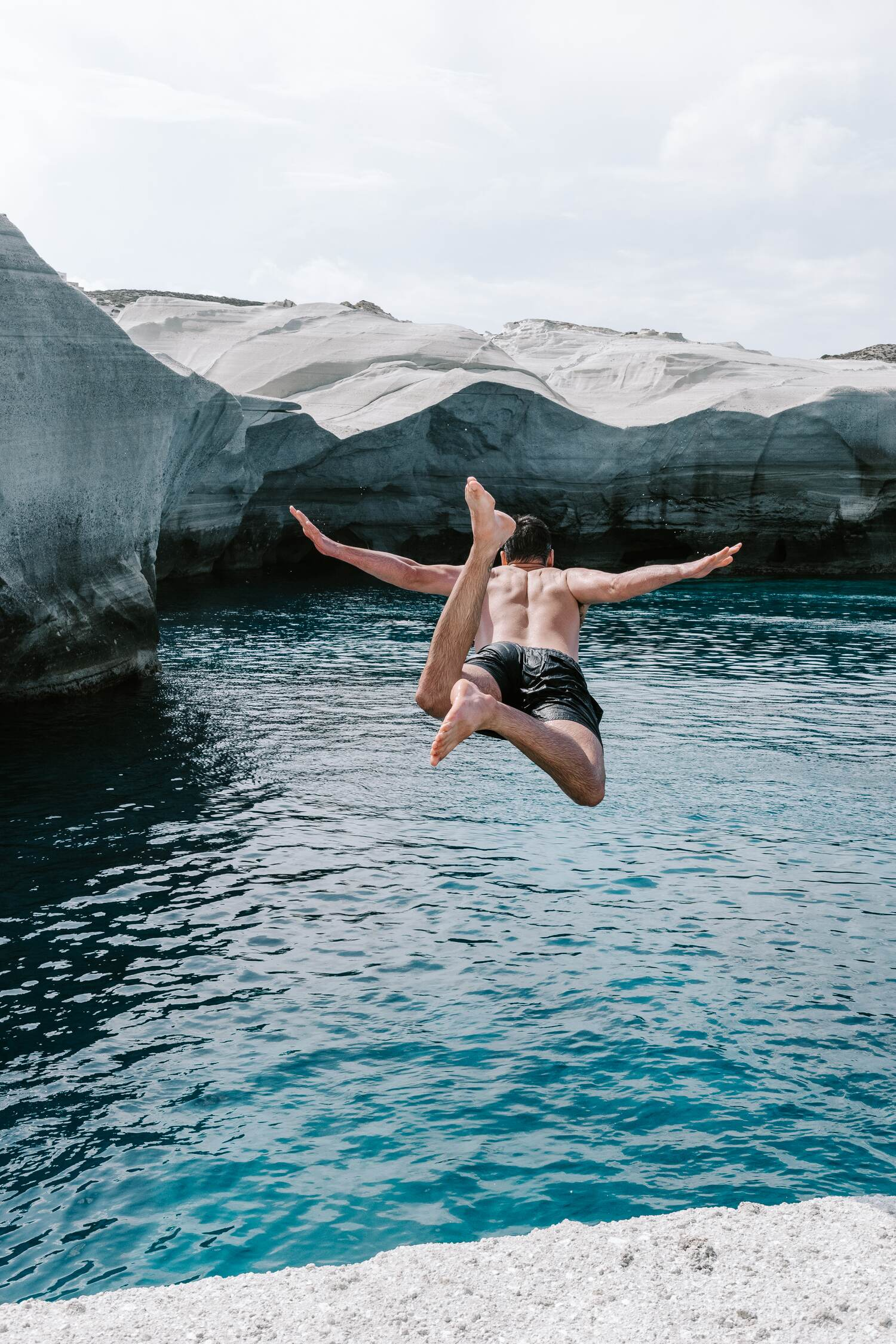 Diving into the magnificent Sarakiniko Beach. One of the best Milos beaches on the greek island Milos