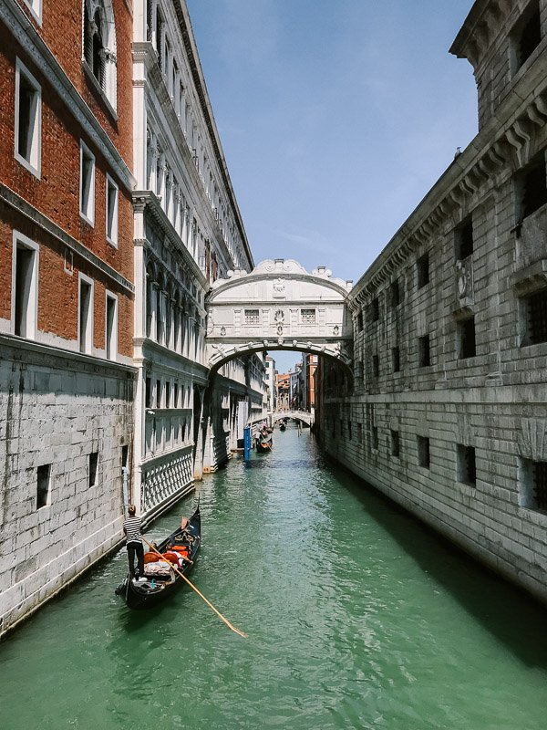 The view of the canal below the Bridge of Sighs in Venice, one of the must see places