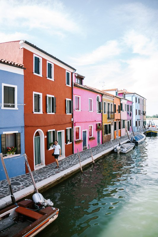 The colourful houses on the canals of Burano are a must visit from Venice Italy