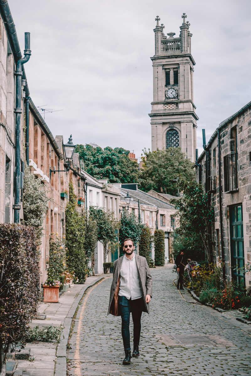 Man walking down Circus Lane in Stockbridge Edinburgh