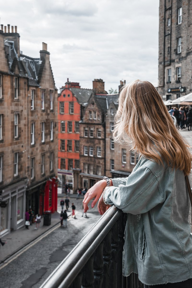 Girl looking down on Victoria Street which is on the list of what to visit in edinburgh